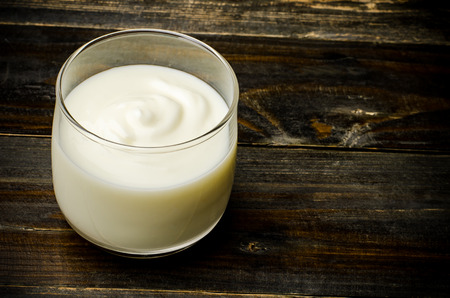 Homemade yogurt in the glass on wooden background,healthy food
