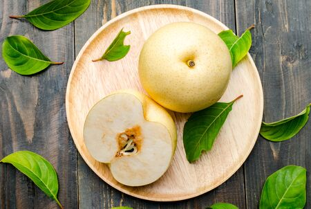 asian pear: Fresh asian pear (tropical fruit) on wooden background Stock Photo