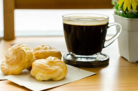 americano: Hot coffee (americano) and choux,breakfast Stock Photo