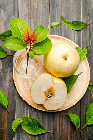 asian pear: Fresh asian pear on wooden background