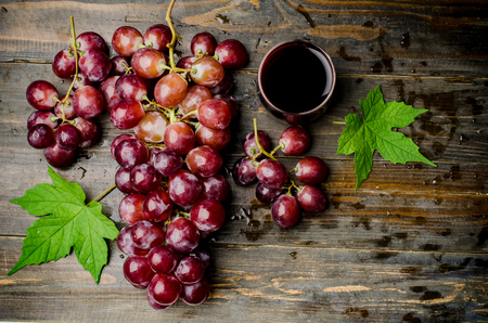 red grape: Fresh red grape and juice on wooden background,healthy food Stock Photo