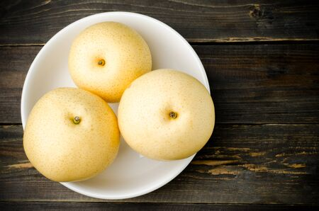 asian pear: Fresh asian pear in the bowl on wooden background