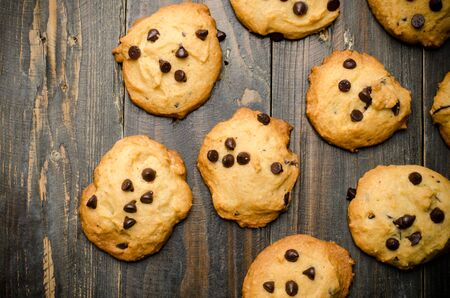 chocolate chip: Homemade chocolate chip cookies on wooden background
