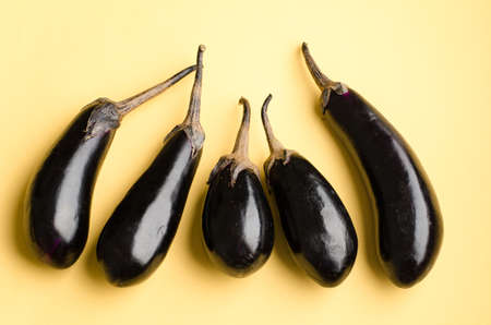 pastel color: Eggplant on yellow pastel color background Stock Photo