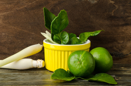 lemon grass: Herb and spice (lime,kaffir lime leaf and lemon grass) on wooden background Stock Photo