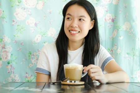 hot asian: Young asian woman drinking coffee in the morning