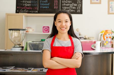 owner: Portrait of woman barista (owner business) in the coffee shop