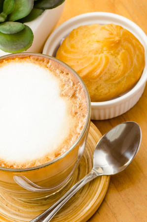 choux: Hot coffee (cappuccino) and choux,breakfast Stock Photo