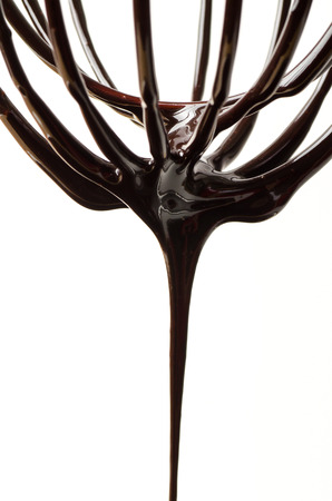 wire whisk: Wire whisk with chocolate sauce,cooking bakery