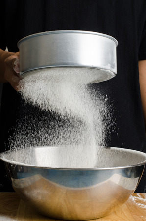 sift: Sifting flour into the bowl,food ingredient,prepare for cooking or baking