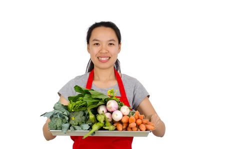 asian cook: Happy woman holding tray of vegetables ready to cooking,isolated on white background