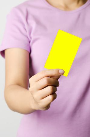 rule: Woman holding yellow card,football rule Stock Photo