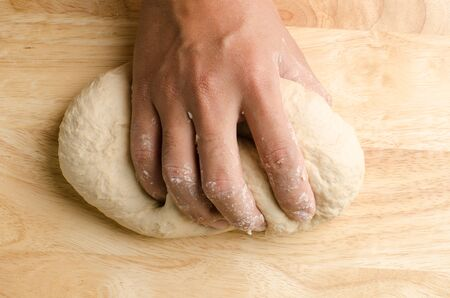 kneading: Kneading bread dough by hand ,bread cooking