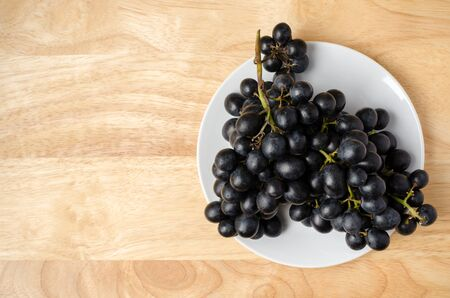 seedless: Seedless grape on wooden background