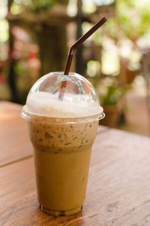 refreshment: Ice coffee on wooden table ,refreshment in summer