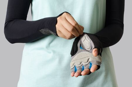 armbands: Woman wearing bicycle glove ready to cycling