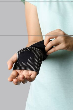 armbands: The woman wearing bicycle armbands for cycling in sunny day