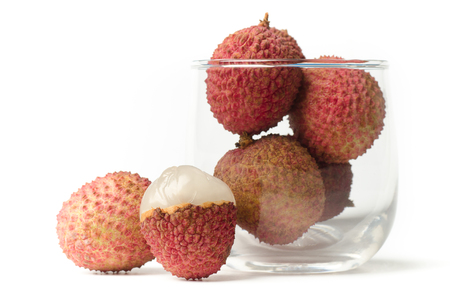 litchi: Lychee or litchi (tropical fruit) in glass on white background