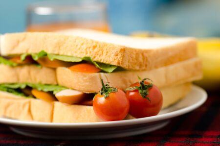 sanwich: Breakfast,meal,sanwich with sausage,lettuce and tomatoes Stock Photo