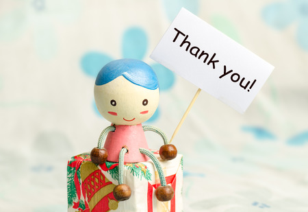 thankfulness: A doll and gift box with thank you card