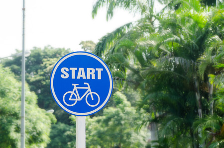 signage outdoor: Bicycle start sign in the park Stock Photo
