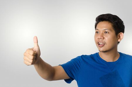 Asia man show thumb up isolated on gray background
