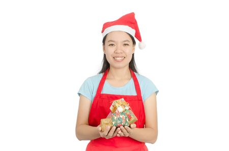prety: Young Asian woman wearing Santa Claus hat and holding gift box to giving in Christmas day, isolated on white background Stock Photo
