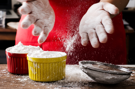 Sifting wheat flour into the bowl,food ingredient,prepare for cooking or baking Stock Photo