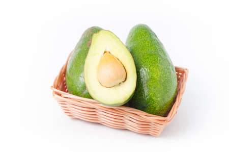 Avocado fruit in a basket on white background,Healthy food