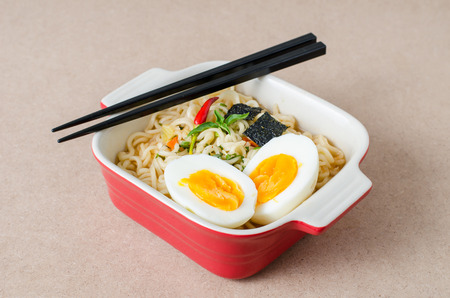 Instant noodles with boiled egg and seaweed in a bowl ready to eating,popular Asian food