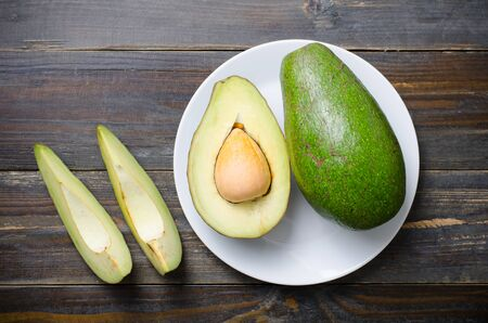 Avocado fruit ready to eating on wooden background,Healthy food Stock Photo