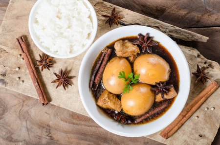 Asian food,hard-boiled egg in brown sauce or sweet gravy,Golden brown egg,Five spices egg,A kind of Chinese dish, In Thai call Khai Palo Stock Photo