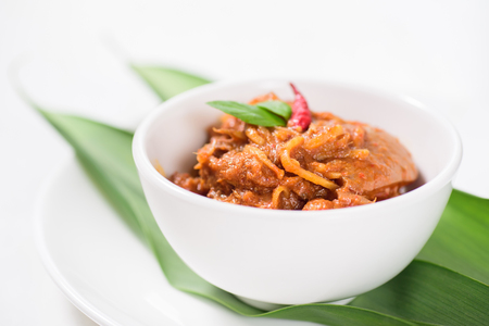 Northern Thai food (Kaeng Hang Le),spicy curry pork mixed with spices in a bowl Stock Photo