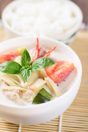 Thai food (Tom Kha Kai), Thai coconut milk soup with chicken and cooked rice Stock Photo