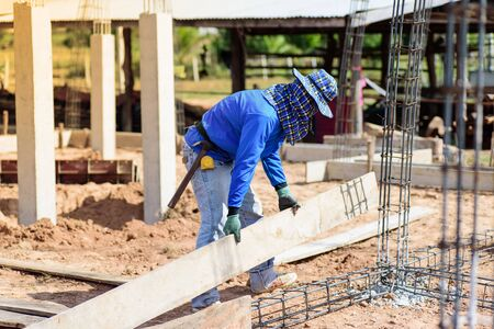 Construction work,the worker making formwork at construction site