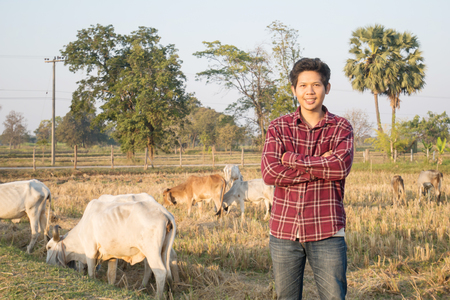 Portrait of Thai cowboy in a field Stock Photo