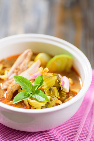 Northern Thai food (Khao soi), curry noodles soup with chicken Stock Photo