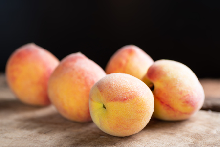 Ripe peaches on wooden, tropical fruit
