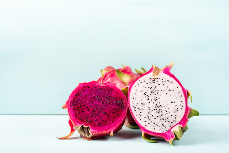 Half dragon fruit on color background, tropical fruit