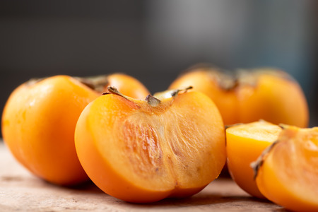 Close up of half and slice persimmon fruit, healthy fruit