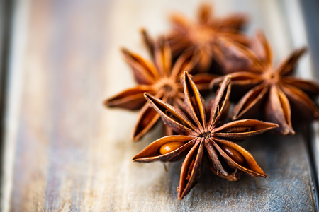 Close up of star anise on wooden table,herbs and spices, food ingredients Stock Photo