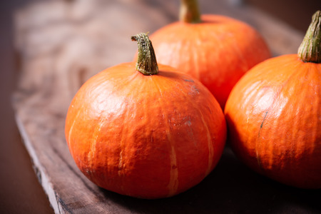 Orange pumpkins on wooden background Stock Photo