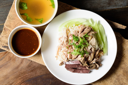 Thai cuisine (Khao Man Kai), Hainanese chicken rice with chili sauce and chicken soup Reklamní fotografie