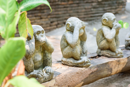 Three monkeys doll closed ears,eyes and mouth in the temple, Thailand