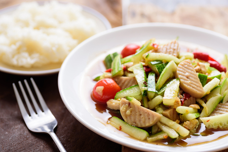 Spicy cucumber salad with steamed pork sausage and sticky rice, Thai food