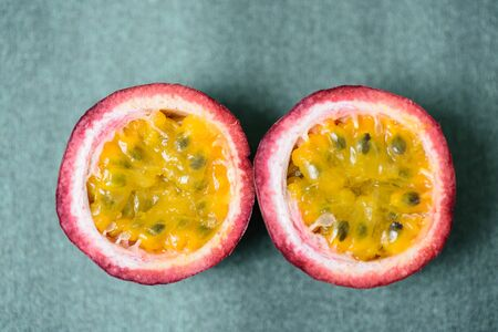 Half passion fruit, tropical and healthy fruit, close up Archivio Fotografico