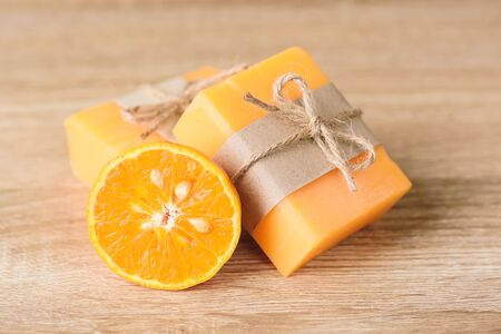 Orange soap wrapping with paper and ribbon, homemade soap