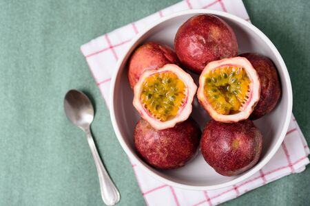 Fresh passion fruit in a bowl, tropical fruit