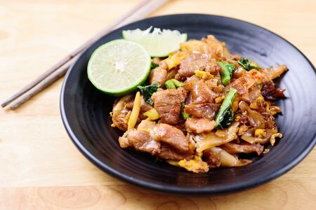 Thai food, stir- fried rice noodle in soy sauce (Pad See Ew)