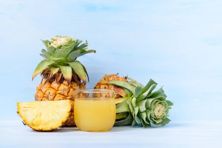 Pineapple juice in glass and fresh pineapple, tropical drink